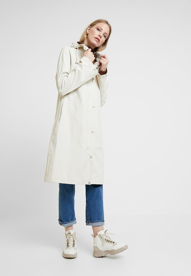 RAINCOAT - Parka - milk creme