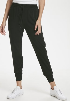 GERDA - Tracksuit bottoms - black