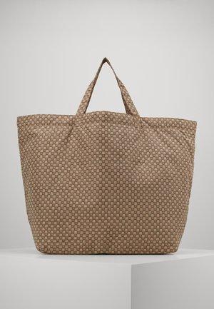 TRAVEL TOTE BAG - Tote bag - beige/black