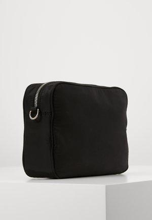 TRAVEL CAMERA BAG - Across body bag - black