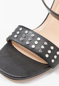 Iro - MAYANI - Sandály na vysokém podpatku - used black - 2