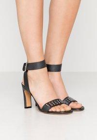 Iro - MAYANI - Sandály na vysokém podpatku - used black - 0
