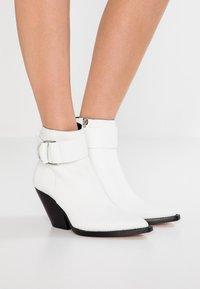 Iro - AREZ - Cowboy/biker ankle boot - white - 0
