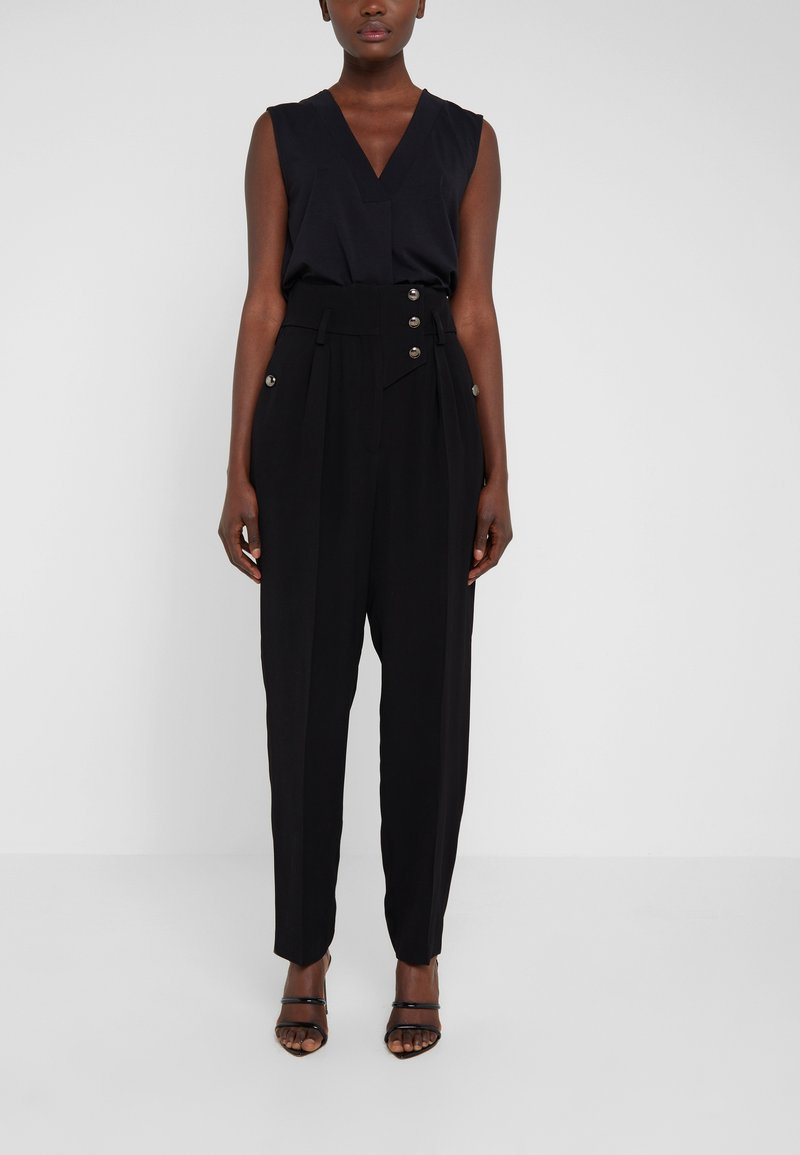 Iro - PUNCH - Trousers - black