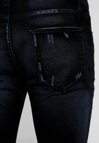 Iro - JORYI - Jeans Skinny Fit - black/dark navy - 5