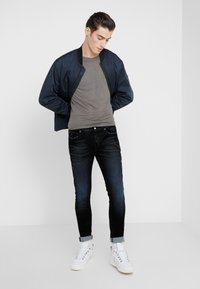 Iro - JORYI - Jeans Skinny Fit - black/dark navy - 1