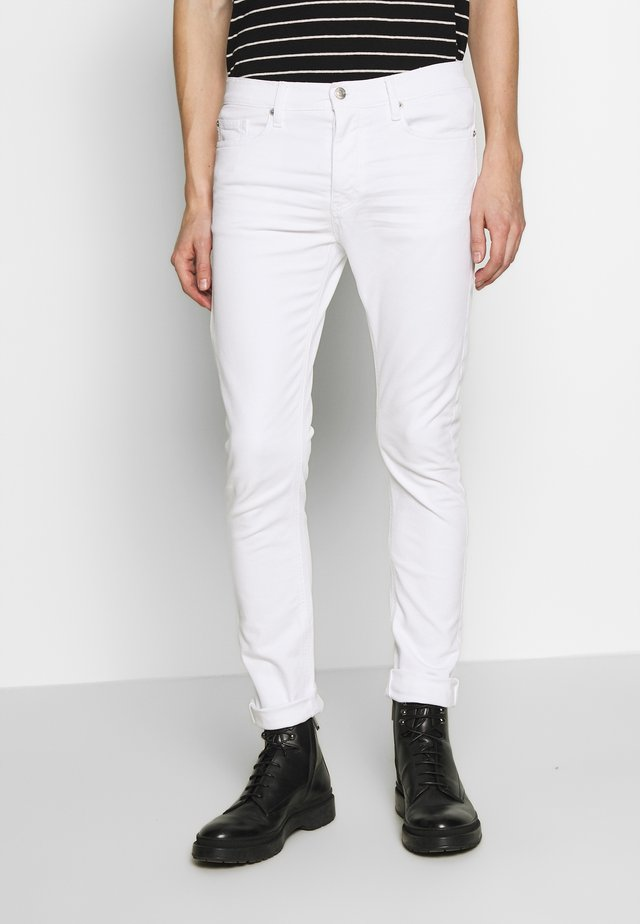PLACIDE - Jeans slim fit - ecru