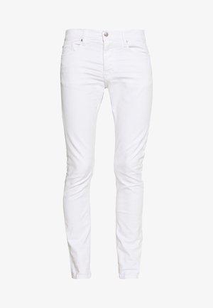 PLACIDE - Slim fit jeans - ecru