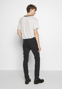 Iro - PLACIDE - Slim fit jeans - black stone - 2