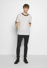Iro - PLACIDE - Slim fit jeans - black stone - 1