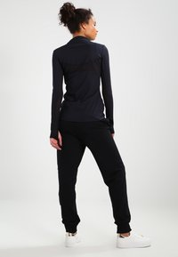 Ivy Park - LOGO JOGGER - Pantalon de survêtement - black/white - 2