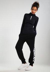 Ivy Park - LOGO JOGGER - Pantalon de survêtement - black/white - 1