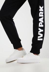 Ivy Park - LOGO JOGGER - Pantalon de survêtement - black/white - 5