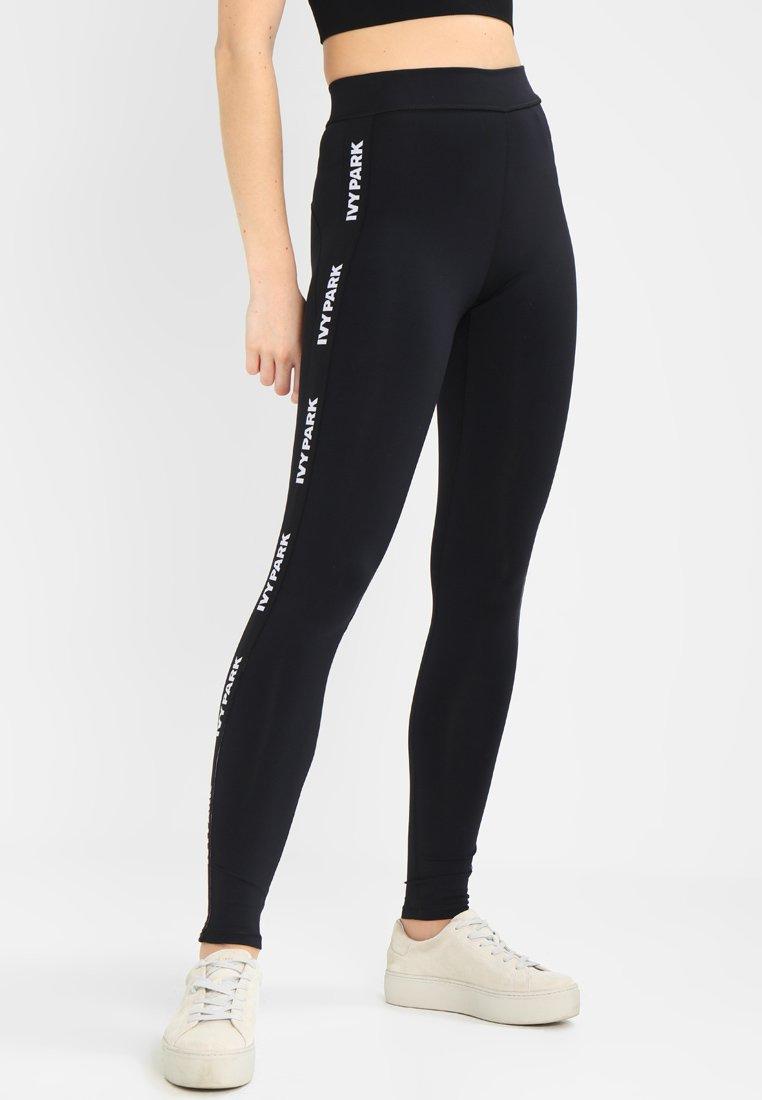 Ivy Park - LOGO ELASTIC - Leggings - Trousers - black