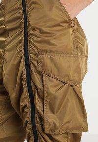 Ivy Park - MILITARY FLIGHT - Trousers - butternut - 4