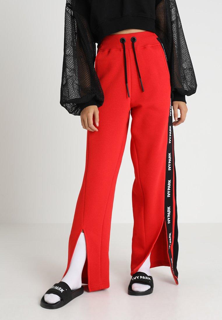 Ivy Park - SPLICED STRIPE JOGGER - Teplákové kalhoty - rose red