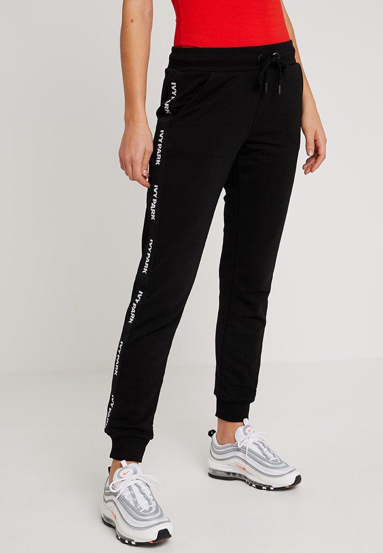 Ivy Park - TAPE LOGO - Pantaloni sportivi - black
