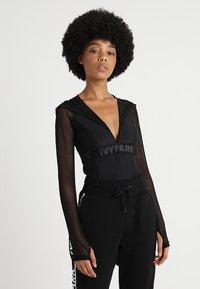 Ivy Park - REGAL DRAPE HOODED BODY - Long sleeved top - black - 0