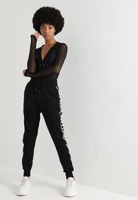 Ivy Park - REGAL DRAPE HOODED BODY - Long sleeved top - black - 1