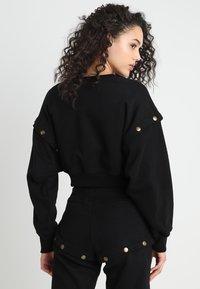 Ivy Park - ARMOUR POPPERS CROP - Sweatshirt - black - 2