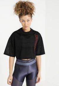 Ivy Park - CRAFT CROP TEE - T-shirt print - black - 0
