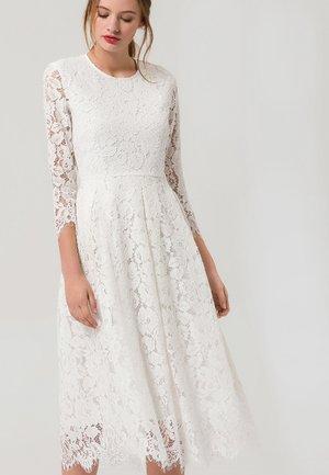 Sukienka koktajlowa - snow white