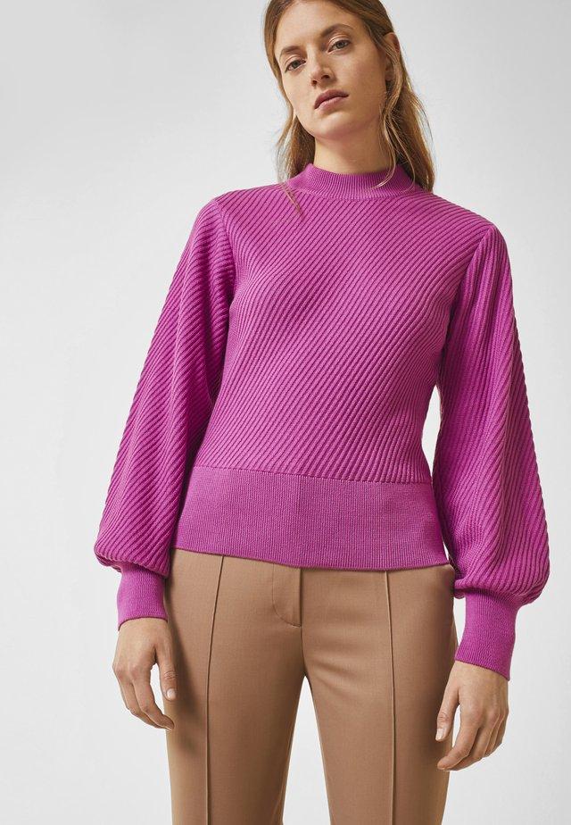 Stickad tröja - super pink