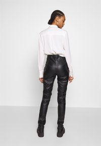 Ivyrevel - FAUX LEATHER TROUSERS - Skinnbyxor - black - 2