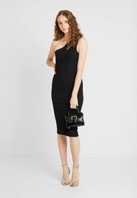 Ivyrevel - CUTOUT ONE SHOULDER DRESS - Koktejlové šaty/ šaty na párty - black - 1