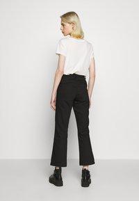 Ivy Copenhagen - ALICE CROPPED FLARE PANT - Bukser - black - 2