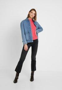 Ivy Copenhagen - JOHANNA KICK FLARE WASH USED EXCELLENT - Bootcut jeans - black - 1