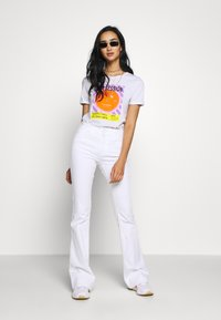 Ivy Copenhagen - CHARLOTTE OPTICAL - Flared jeans - white - 1