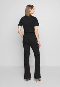 Ivy Copenhagen - CHARLOTTE FLARE TRACKSUIT COOL - Overall / Jumpsuit /Buksedragter - black - 2