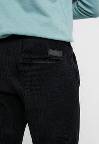 Just Junkies - BOX CORDUROY - Trousers - black - 5