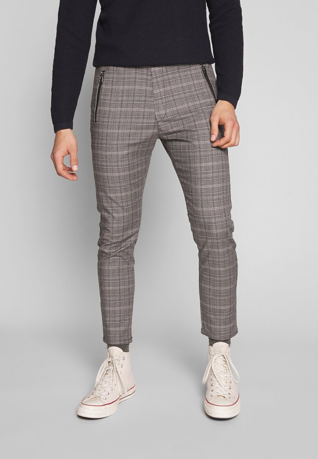 FLEX - Trousers - check / grey