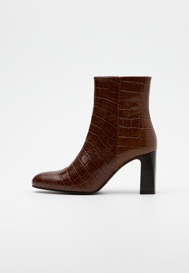 DEBANI - Classic ankle boots - marron