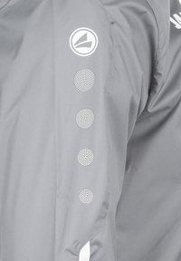 JAKO - STRIKER 2.0 ALLWETTERJACKE HERREN - Outdoor jacket - steingrau / weiss - 3