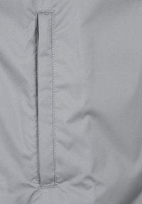 JAKO - STRIKER 2.0 ALLWETTERJACKE HERREN - Outdoor jacket - steingrau / weiss - 4