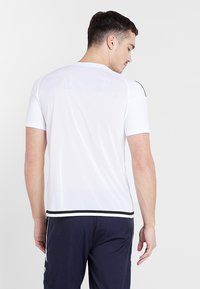 JAKO - TRIKOT STRIKER 2.0 - T-shirt imprimé - weiß/schwarz - 2