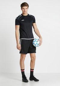 JAKO - TRIKOT STRIKER 2.0 - T-shirt imprimé - schwarz/weiß - 1