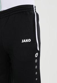 JAKO - ACTIVE - Tracksuit bottoms - schwarz - 3