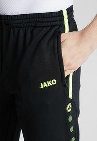 JAKO - ACTIVE - Pantalones deportivos - schwarz/neongelb - 5