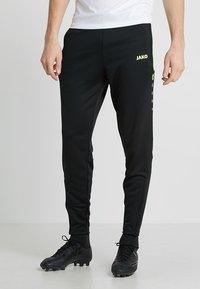 JAKO - ACTIVE - Pantalones deportivos - schwarz/neongelb - 0