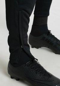 JAKO - ACTIVE - Pantalones deportivos - schwarz/neongelb - 3