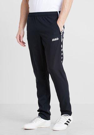 STRIKER - Pantalones deportivos - schwarz/weiß