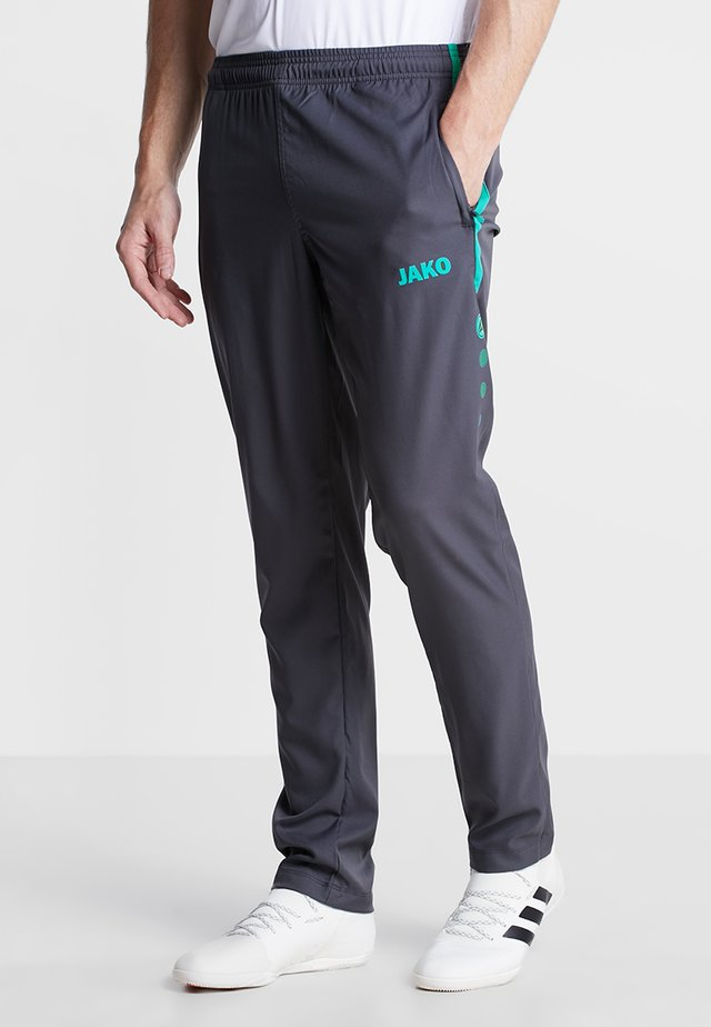 STRIKER - Tracksuit bottoms - anthrazit/türkis