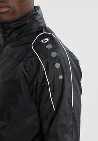 JAKO - TEAM - Impermeable - schwarz - 5