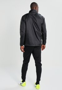 JAKO - TEAM - Impermeable - schwarz - 2