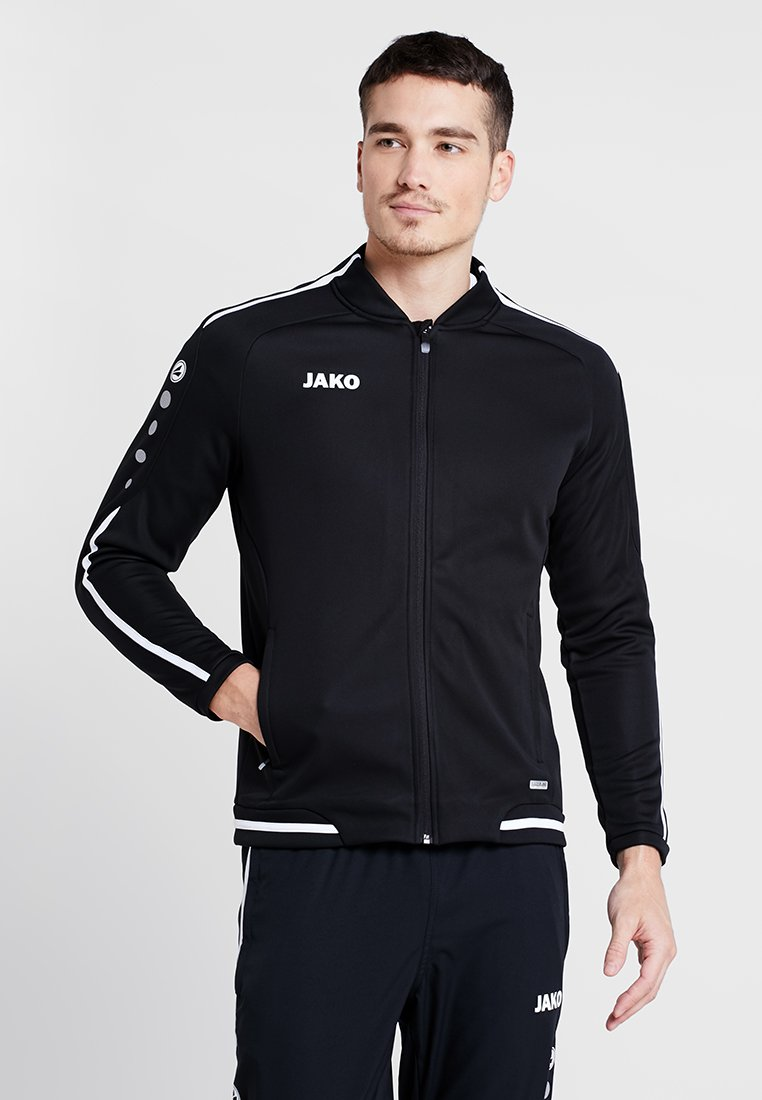 JAKO - STRIKER - Fleece jacket - schwarz/weiß