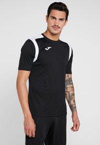 Joma - CHAMPION - T-shirt imprimé - black/white - 0